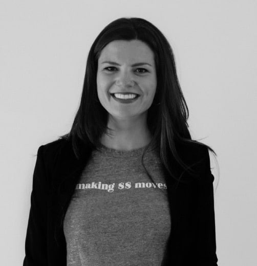 black and white photo of smiling female tech startup founder in a blazer