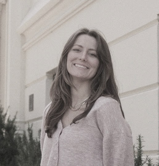 young smiling female fintech founder wearing a cardigan
